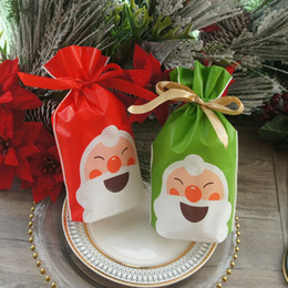 2020 saco de presente projetado de plástico 23*15cm 50pcs Red Green Christmas Smiling Santa Design Bag Cookie Candy Handmade Party Favors Gift Plastic Packaging Bags desconto saco de presente projetado de plástico