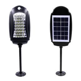 Luces de carretera solar led online-Impermeable 32led Solar Street Lights Lámpara de jardín al aire libre Luces + Sensores de movimiento Solar Lámpara de pared Seguridad vial Luz de emergencia con control remoto
