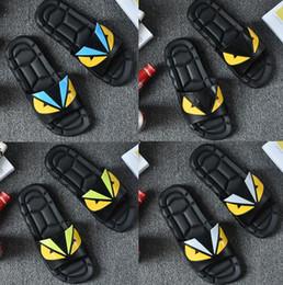 Ojos sandalias online-Diseñador Zapatillas Ojo Monstruo Clásico Europa Lujo Hombre Marca casual Air Beach Sandalias con estilo Medusa Scuffs Zapatillas Sandalias sin cordones