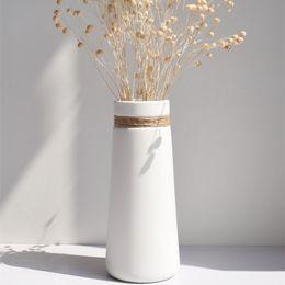 2019 florero de cerámica blanca Cerámica blanca cuerda creativa jarrón maceta decoración del hogar accesorios artesanías decoración de la habitación Arte porcelana jarrones flores regalos florero de cerámica blanca baratos