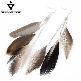 MISANANRYNE vendita calda gioielli indiani boho orecchini pendenti colorati lungo piuma nappa etnico orecchini di goccia nuovo brincos per le donne cheap indian earrings for sale da orecchini indiani in vendita fornitori