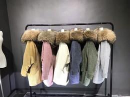 2019 pele aparada casaco parka Imagens reais pele de cordeiro forrado longo parka com pele luxuosa guarnição mulheres casacos de inverno pele aparada casaco parka barato