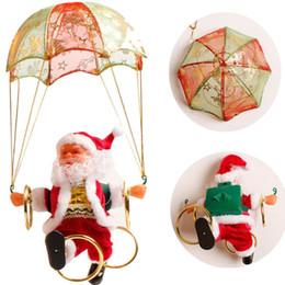 Pingente elétrico on-line-Elétricos Papai Noel do Natal Brinquedos de suspensão rotação Parachute Ligue Musical Festa Toy elétrica Pingente Criança Supplie New TTA2134-2