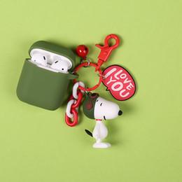 Cute Cartoon Anime Charlie Brown y perro muñeca llavero Bluetooth inalámbrico para auriculares Funda protectora Airpods Llaveros desde fabricantes