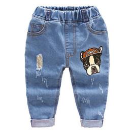 Pulir los pantalones vaqueros online-2018 Moda Niños Niños Pantalones de Dibujos Animados Pantalón Bebé Niñas Muelas Agujeros Jeans Niños Primavera Otoño Ropa 2-6years J190522