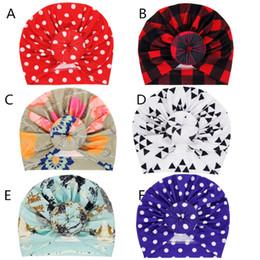 2019 gorro de lana tejido a mano Baby Girls moda hecha a mano Turban 6 colores ins patrones de geometría caliente Dots Plaids flor Bonnet Infantes lindo donut sombreros