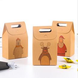 Caja de regalo creativa de papel kraft Papá Noel envoltura de regalo de dibujos animados mano caramelo pequeña caja de papel desde fabricantes