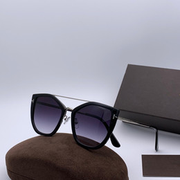 Paquete original de gafas de sol online-Lujo 0648 Gafas de sol para mujer Ojo de gato Marco completo Gafas de sol de diseñador de moda Protección UV de calidad superior Vienen con el paquete original