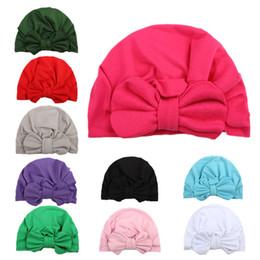 riscaldatori dell'orecchio di ciclismo Sconti Nuovo 2019 arco berretto legato del bambino cappello indiano cappello dei bambini europei e americani prodotti del bambino