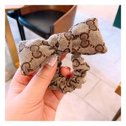 Hairbands muchachas de las mujeres de lujo superior hermoso Marca perla de la mariposa retro Impreso Moda Accesorios para el cabello desde fabricantes
