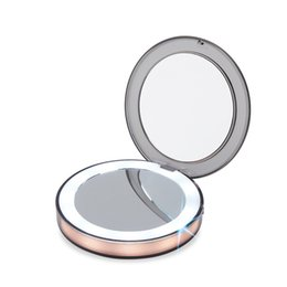 Argentina LED Mini espejo iluminado de maquillaje Pantalla táctil portátil de viaje tres veces Lupa tipos coloridos Plegable espejo ajustable QQA275 cheap magnified mirror glass Suministro