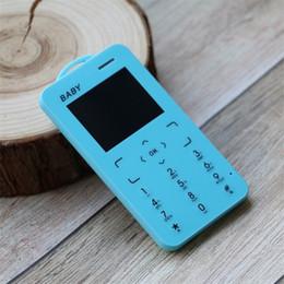 gsm-kisten Rabatt Das Telefon des Kindes mini einfaches Kind Bluetooth 2G G- / Munterstützungs-TF-Karte einzelnes SIM MP3 Musik spielt Geschenk-Telefon der Karikatur-T5 mit Siegelkasten