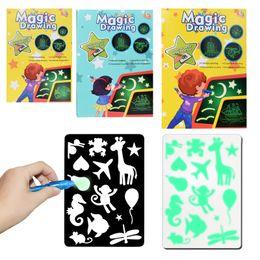 Juguetes fluorescentes online-Venta caliente magia dibujo niños educación científica enseñanza luz LED electrónica mano tablero de escritura fluorescente tablero de escritura juguetes