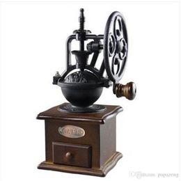 Ruedas de metal vintage online-Envío gratis ventas al por mayor Vintage molinillo de café diseño de la rueda molino de grano de café molino máquina