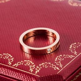 золотые кольца мальчика Скидка Дизайнерский бренд ювелирные изделия кольца Мужчины / женщины Полный CZ Алмазный Любовь Кольцо Золото 3 Цвет Пара кольцо титана стали отполированный Lover кольца с коробкой