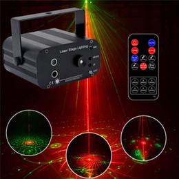 Control remoto de luz dj online-48 patrón láser proyector remoto / control de sonido LED Disco Light RGB DJ Party Stage Light Light Lámpara de Navidad Decoración