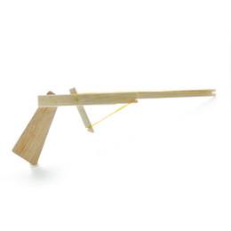 Бесплатная доставка головоломка модель игрушек детский пистолет бамбуковая игрушка народный промысел детский бамбуковый игрушечный пистолет от Поставщики палка в любом месте