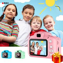 2019 telecamere a zoom lungo Mini giocattoli della fotocamera digitale per Screen Kids 2 pollici HD Chargable Fotografia Props Cute Baby sitter, Regalo di compleanno Gioco da Esterni