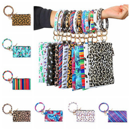 Женские кошельки леопарда онлайн-PU Leather Tassels Bangle Wallet Leopard Purse Keychain Bracelet Bag Women Girls Fashion Wristlet Bags HHA1337