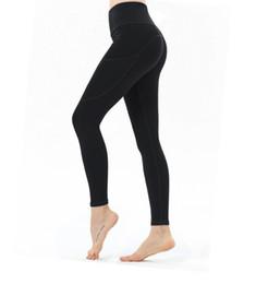 Roupa de ioga para as mulheres longas pernas outono inverno esportes das mulheres de cor sólida mostrar fino levantamento nádegas cintura alta yoga calças apertadas de Fornecedores de carvão rápido