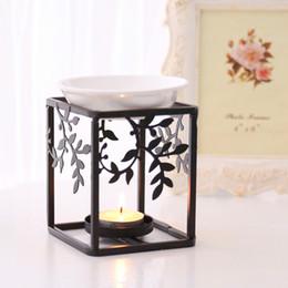 Forni in ceramica online-Art Iron Stand Bruciatore a nafta in ceramica Aromaterapia Fornace Olio essenziale di alta qualità Aromaterapia Lampada a olio Regali Artigianato Decorazioni per la casa