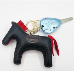 Logotipo de lujo de París caballo Famoso Hecho A Mano de Lujo de Cuero de LA PU Caballo Llavero Animal Llavero Bolso de Las Mujeres Encanto Colgante Accesorios desde fabricantes