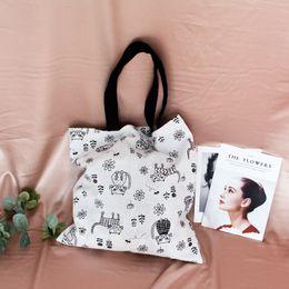 2019 bolsos de niña de flores negro Gato Flor Negro Impreso Lienzo Tote Bag Mujeres Chica Reutilizable Bolso de Compras Bolso Bolsas de Comestibles Casual # 31319 rebajas bolsos de niña de flores negro