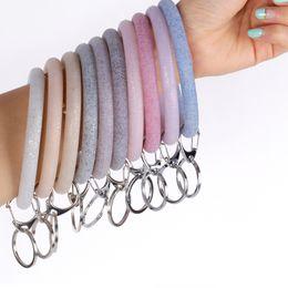 Silikon-Handgelenk-Schlüsselring-Art- und Weiseglitter-Armband-Sport Keychain-Armband-Armband-runde Schlüsselringe großer O-netter Schlüsselring-Schmuck GGA2511 von Fabrikanten