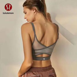 Chemises de gym dames en Ligne-Soutien-gorge en cours d'exécution Sports Shirts Yoga Gym Gilet Push Up Fitness Tops Sexy Sous-Vêtements Lady Crop Tops Shakeproof Sangle Réglable Soutien-Gorge