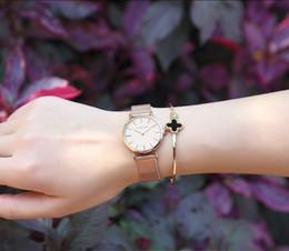 Mode große marke frauen edelstahlband quarz armbanduhr luxus einfachen stil entworfen uhren frauen uhr von Fabrikanten