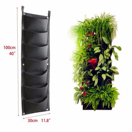 Plantas de flores ao ar livre on-line-Novo design 7 bolsos Outdoor Indoor Jardim Vertical Plantando Bag Hanging Wall Varanda de semente Supplies Flower Pot Diy Decor