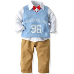Chalecos de bebé de manga larga online-Otoño Invierno Traje para niños Chaleco de lana con letras para niños Chaqueta de manga larga Camisas Pantalones para bebés Versión coreana Cuatro juegos