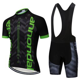Jersey de ciclismo manga corta negro online-2019 Black Green Pro Jersey Ciclismo Maillot Ciclismo Manga corta y babero Ciclismo Shorts Correa ropa ciclismo XXS-6XL
