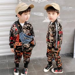 2019 весна детская дизайнерская одежда для мальчиков комплекты одежды для мальчиков спортивный костюм модная куртка пальто + брюки детский тренировочный костюм детская одежда A3337 cheap jackets sweats от Поставщики жакеты поты