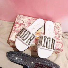 Argentina sandalias de cuero de moda los zapatos casuales 2020 de venta directa de fábrica Paris pasarela de alta calidad en blanco y negro zapatillas de cuero planas Suministro
