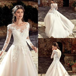 b5fb8421928 2019 Gorgeous Sheer Neck Long Sleeve A Line Wedding Dresses Appliques Floor  Length Bridal Gown Covered Button Back robe de mariee BC0936