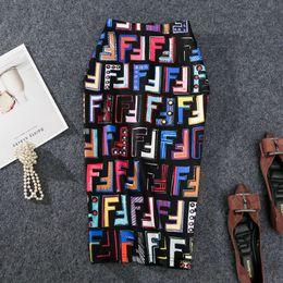 multi cores bola vestidos meninas Desconto 2019 New-coming Europeu Verão Mulheres Saia Lápis de Alta Carta de Estiramento Graffiti Impresso Midi Slip Hip Saia Feminina Y19043002
