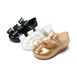 Sandalo delle bambine online-Mini Melissa stile 2019 nuove ragazze piccola farfalla Jelly Sandals nodo della farfalla inferiore molle Ragazze sandali del bambino pattini della spiaggia