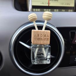 Con clip Madera 8ML Coche Colgante Perfume Ornamento retrovisor Cubo Perfume botella Ambientador para aceites esenciales Difusor Fragancia desde fabricantes