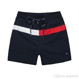 Argentina 2019 Venta al por mayor-verano MenTommy pantalones cortos de playa Ropa de marca Traje de baño Pantalones cortos de playa para hombre de nylon Ropa de baño caliente Pantalones cortos de tabla HOT Suministro