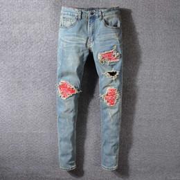 jeans boutique all'ingrosso Sconti Mens Designer Pantaloni Uomo Slim strappato strappato Zipper Jeans Marchio Moda Uomo Hip Hop Jeans blu 29-40