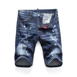 Moda de jeans rotos online-Pantalones cortos de lágrima de mezclilla para hombres D Longitud de la rodilla Pantalones vaqueros Club nocturno Azul Moda de algodón Apretado verano Hombres Pantalones cortos con rotos LJJA2571