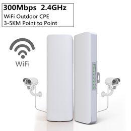 Puente wifi inalámbrico online-2pcs / lot 300 Mbps 2,4 GHz inalámbrico al aire libre Mini WIFI puente CPE punto de acceso WiFi Dual 2 * 14dBi WIFI Antena WIFI Red Net Bridge HHA102