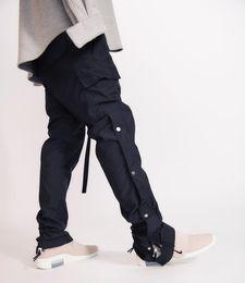 Fibbie sciolte online-Streetwear Hip hop Fear of God Tinta unita sciolto magia appiccicosa Snap Pantaloni dritti nylon scuro fibbia Pantaloni tuta