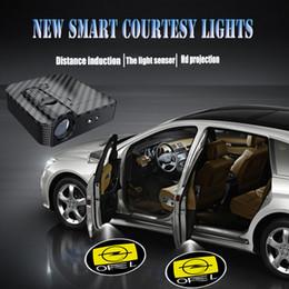 Canada 1 paire extérieur en fibre de carbone Pour OPEL Auto lumière de bienvenue sans fil Projecteur Ghost Laser Porte De Voiture LED Courtesy Logo lampe Offre