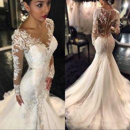 Maniche lunghe di vestiti da cerimonia nuziale online-Splendido pizzo abiti da sposa sirena 2019 Dubai arabo arabo stile Petite maniche lunghe abiti da sposa Plus Size