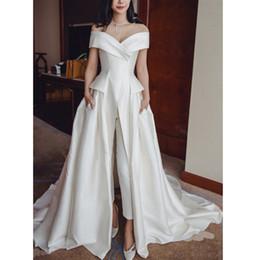 vestido verde esmeralda imperio Rebajas 2019 elegante Ivory Satin Jumpsuit vestidos de noche fuera del hombro Vestidos de baile con bolsillos Custom Sweep Train V Neck Women vestidos formales