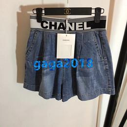 Pantalones de punto online-mujeres niñas pantalones cortos de mezclilla azul botón de retazos de punto pantalones vaqueros de alta costumbre sueltos mini pantalones cortos falda verano milan pantalones