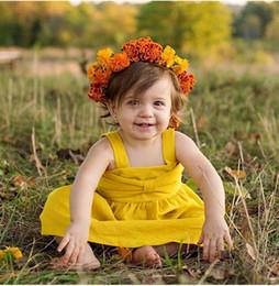 Argentina Nuevos bebés vestidos de los niños amarillo sin mangas de algodón de la liga vestidos 2018 verano lindo niño ropa para niños cheap yellow dresses for toddlers Suministro
