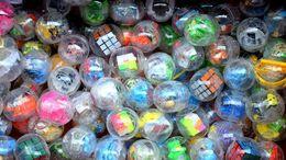 Máquina de torsión online-Pascua de plástico transparente de huevo torcido cubo dinosaurio de juguete coche de juguete mezclado bola de la máquina máquina de juegos de regalo